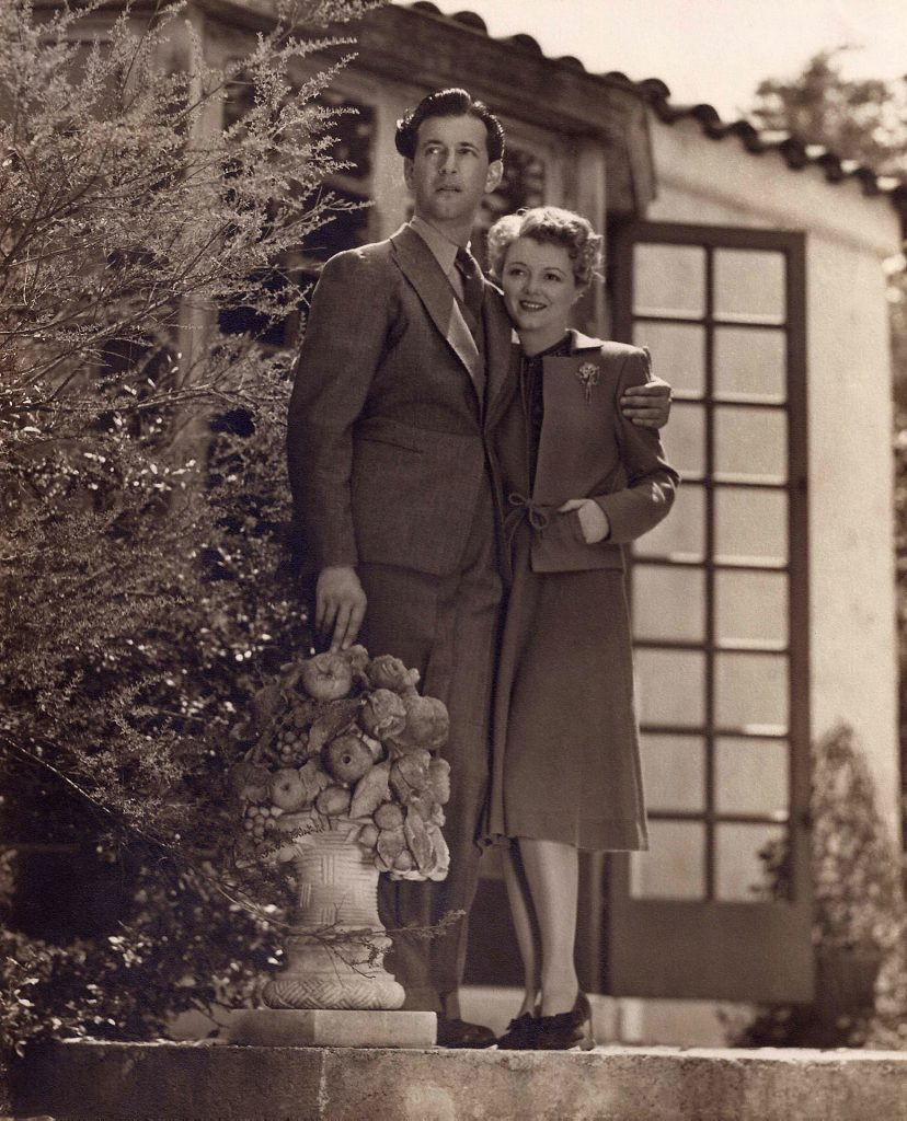 Janet Gaynor and Adrian in the yard